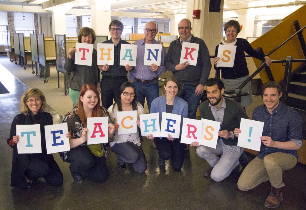 staff holding thanks teachers sign