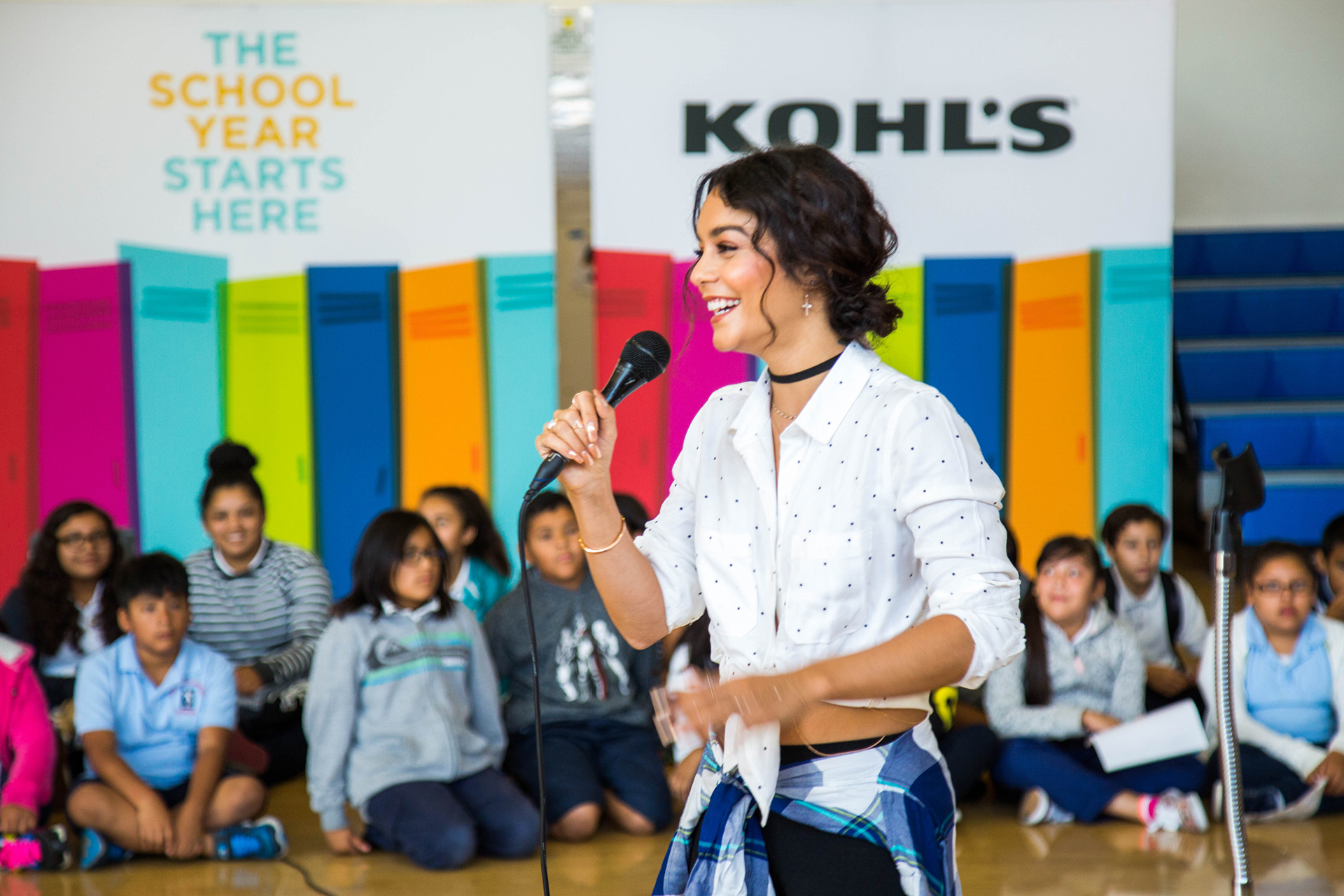 Actress and singer Vanessa Hudgens tells students they are getting free Nike sneakers in LA, California on August 17, 2016