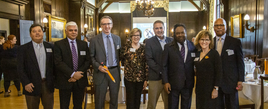May, 2019 fundraising event at the Minneapolis Club for Benjamin E. Mays School. (From left: Jay Kim, Rahoul Ghose, Patrick Strother (AAC Board), Patricia Strother, Ryan Vernosh (AAC Board), Alexs Pate (Innocent Classroom), Ann Pifer (Executive Director, AAC), Cornell Moore.